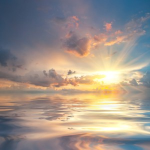 Sunset over sea with reflection in water